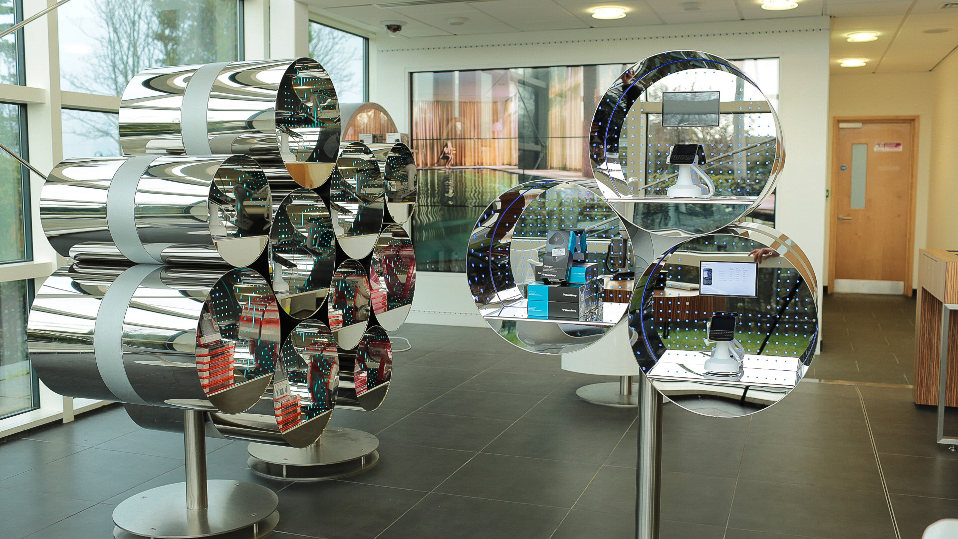 Mobile phone display pods with intergrated digital screens