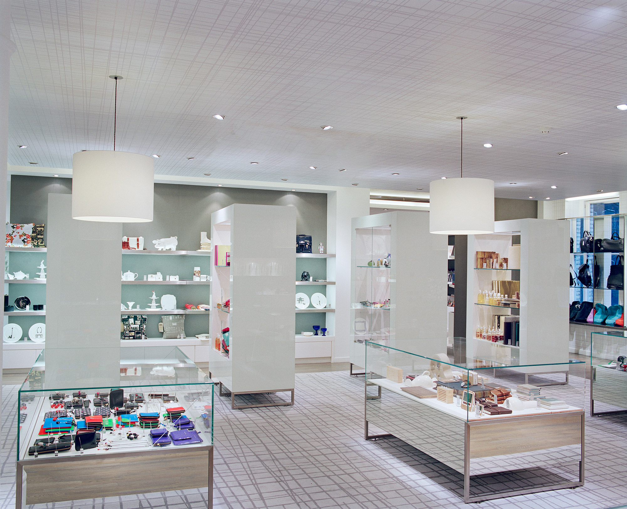 Paperchase Tottenham Court Road, retail interior, glass floor units with white shelving