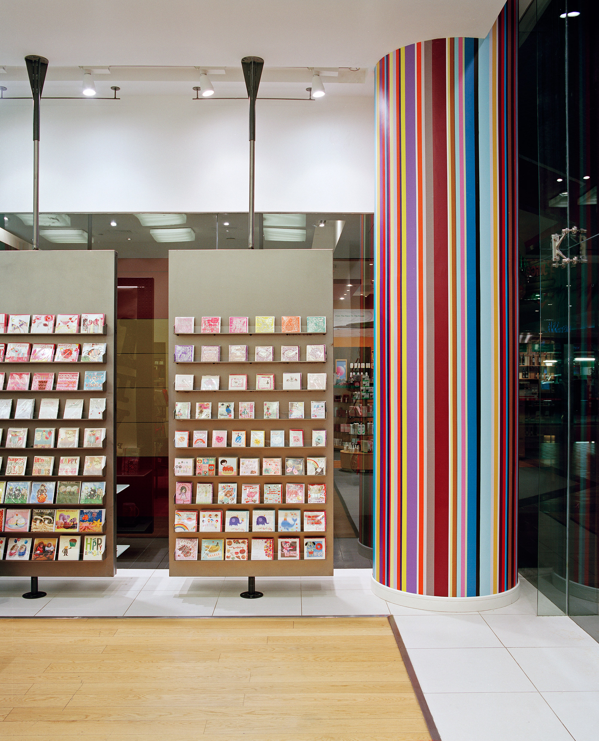 Paperchase Dubai suspended card racks and Paperchase striped pillar