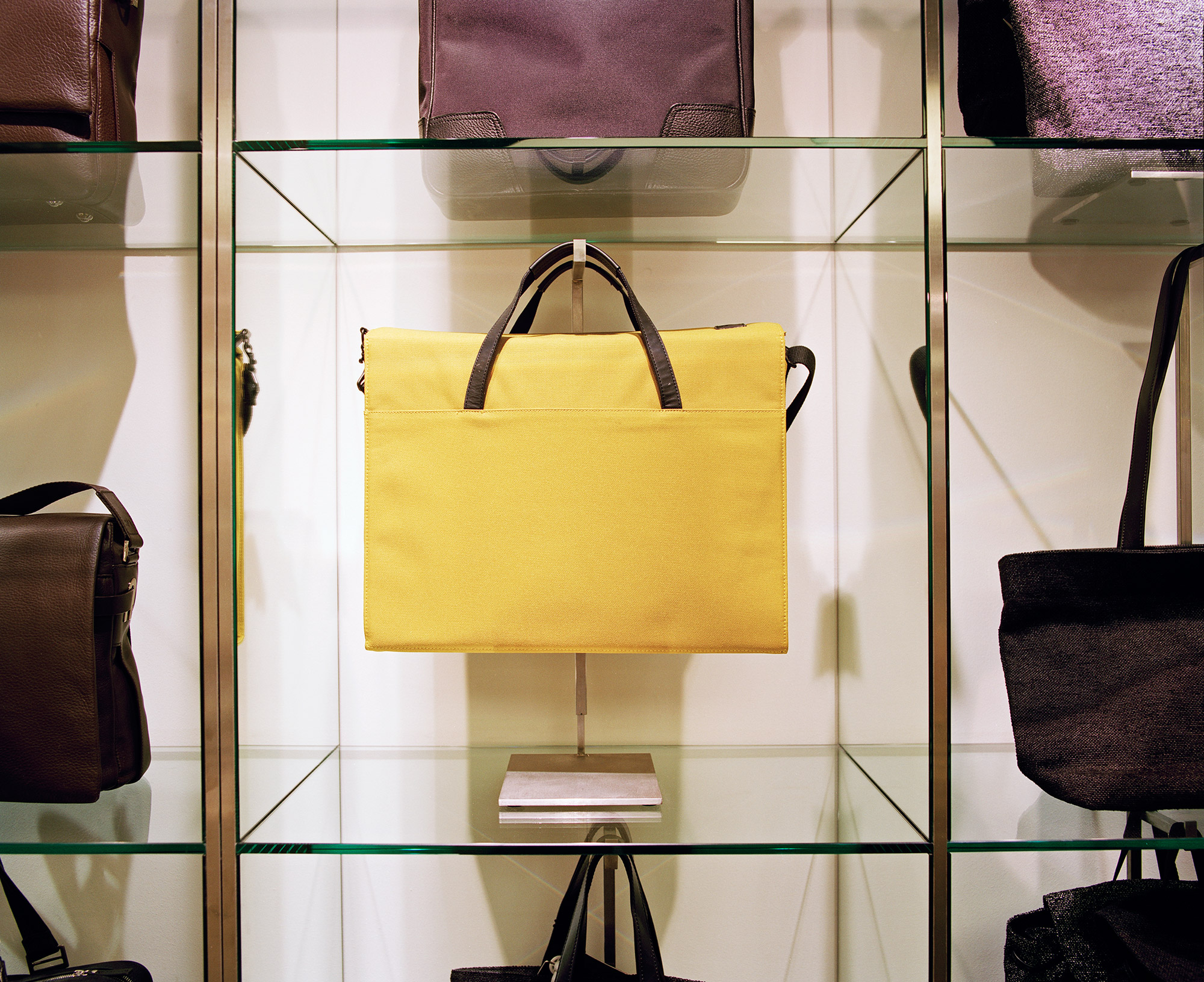 Paperchase Tottenham Court Road, square glass shelving featuring yellow bag