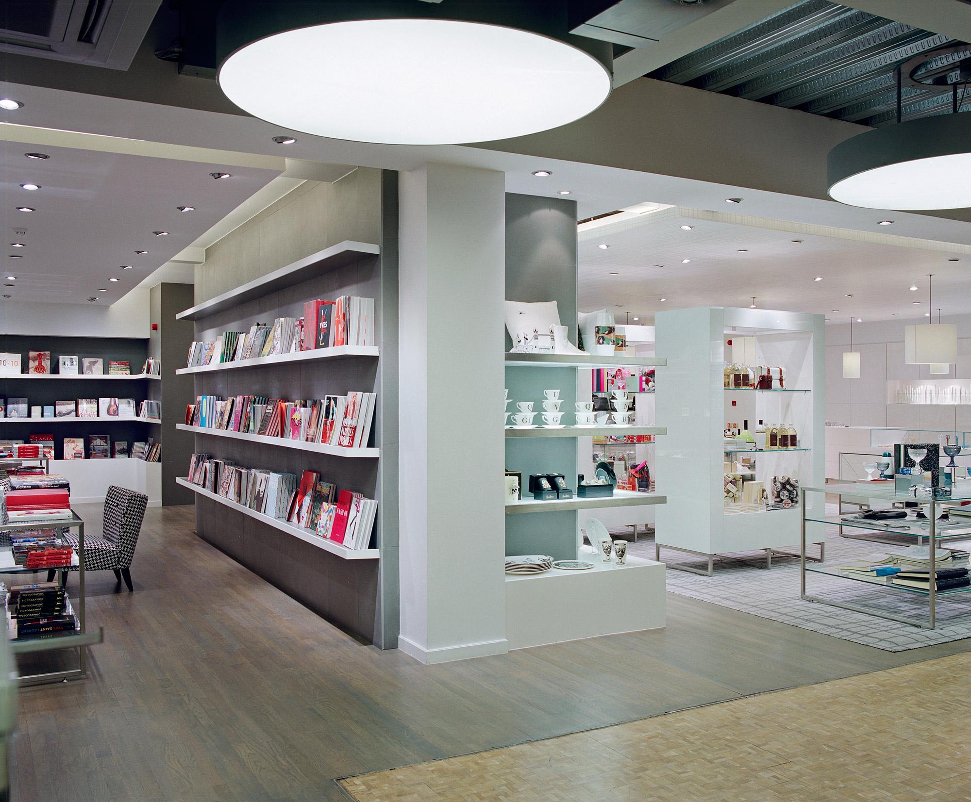 Paperchase Tottenham Court Road, white book shelves, large circular light