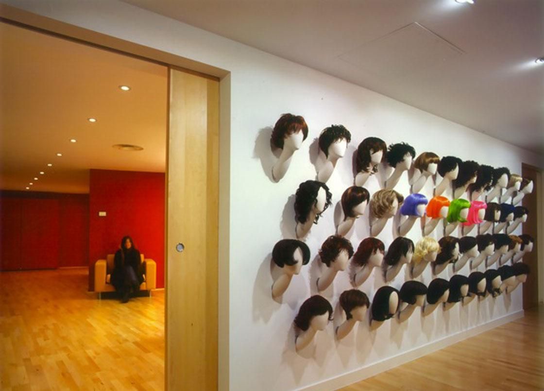 A wall of heads at Feme head office, London,