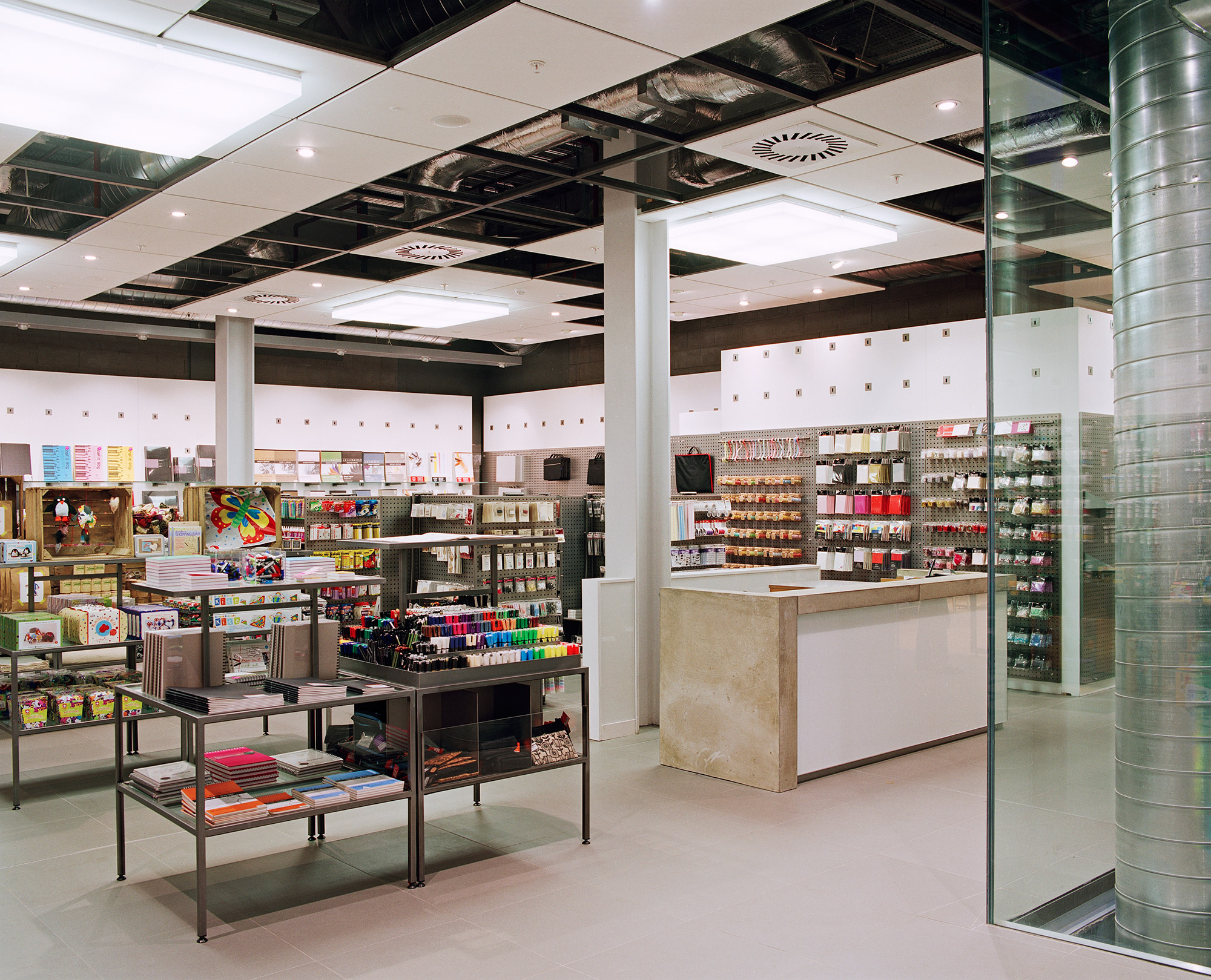 Paperchase Glasgow first floor, concrete cash desk and lighting