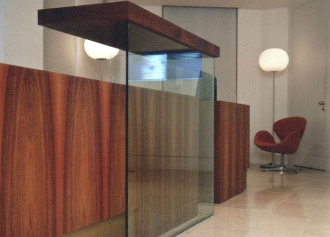 Bespoke glass and wooden reception desk, Reuters, London