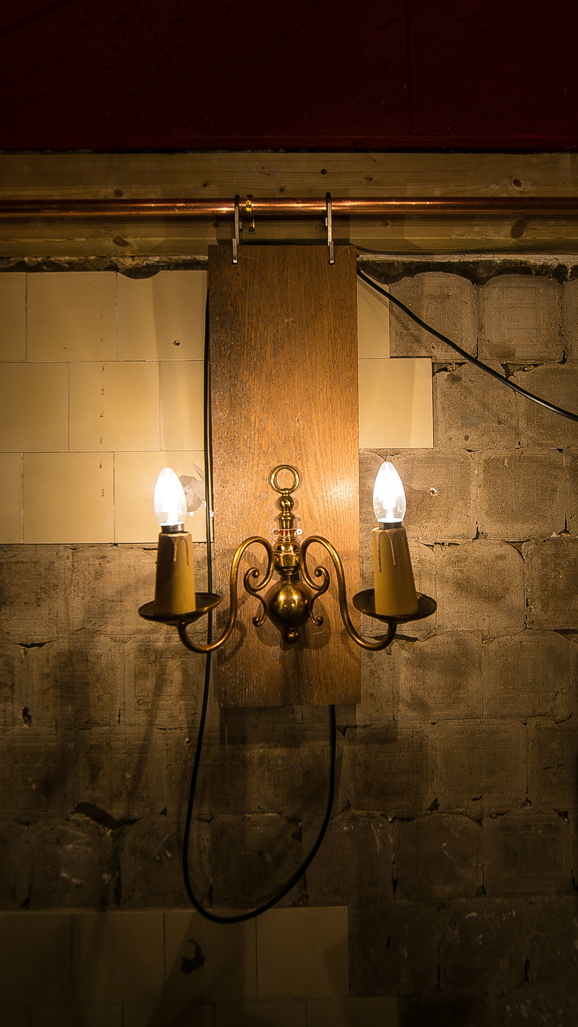 Custom made wall light, vintage wall light, wood flooring light at Cellar Magneval, Woking