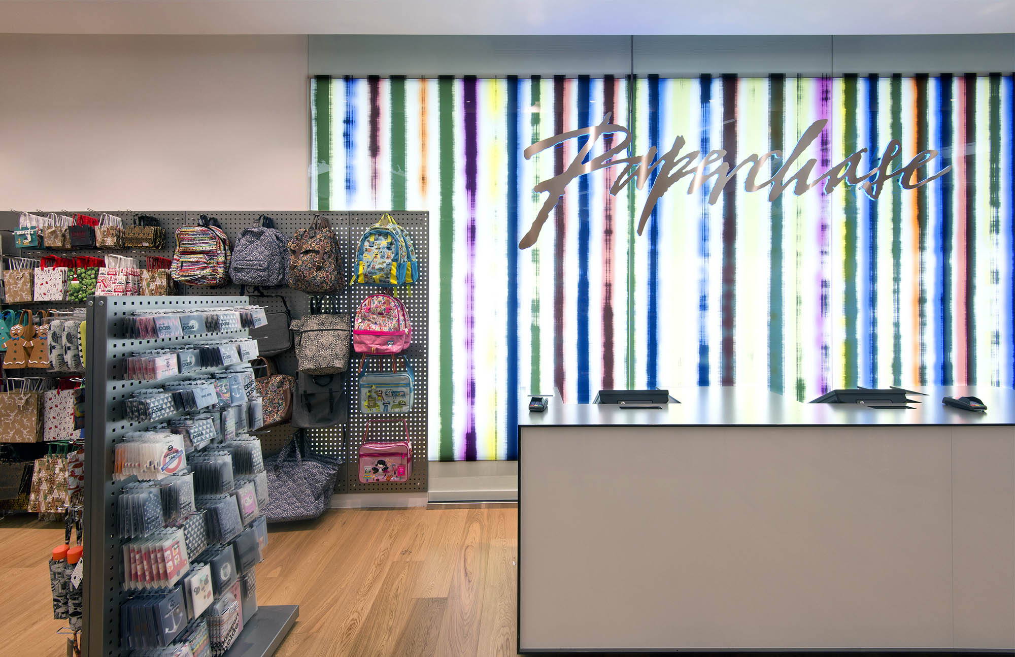 Illuminted back panel at Paperchase Bishopsgate, featuring Paperchase logo