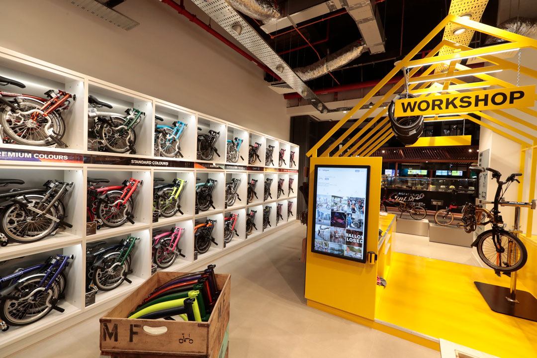 Brompton Junction Singapore wall of bikes by Made In Place Design