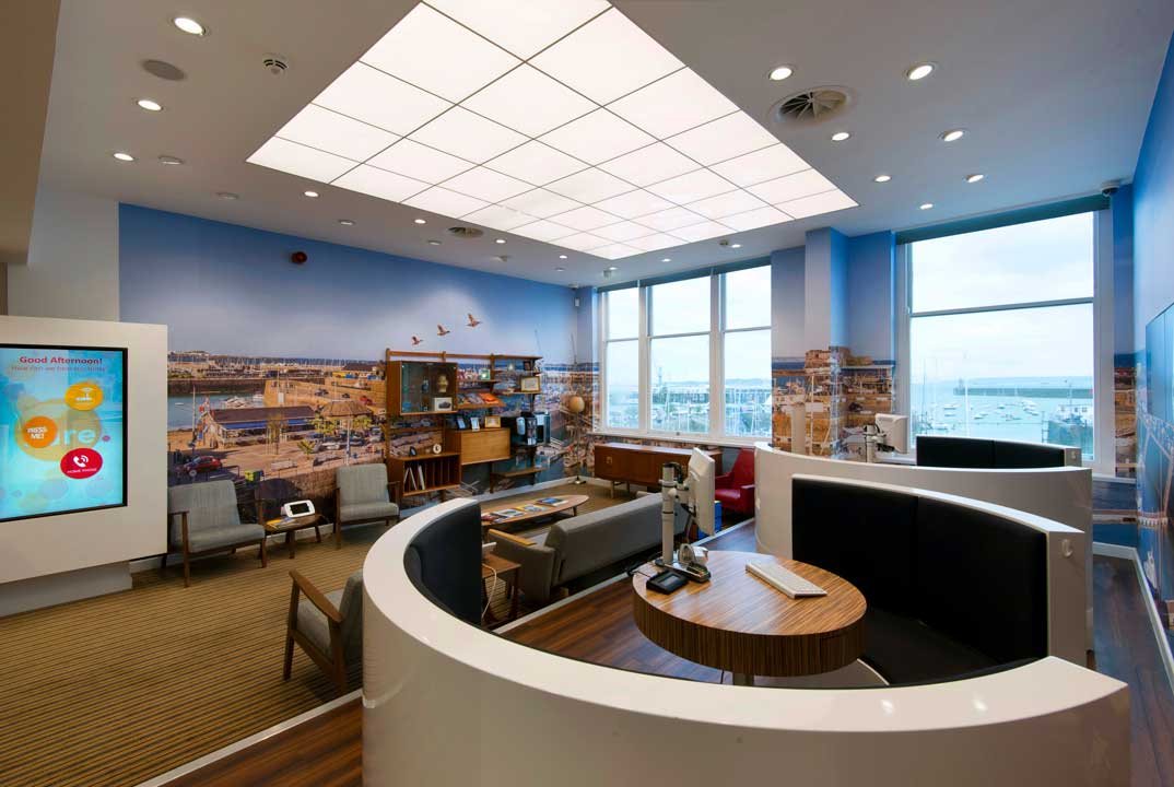 sure-telecom-guernsey-retail-interior-seating-area-and-screens